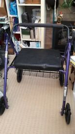 Large size rollator with seat, brakes and under seat basket. Excellent condition.