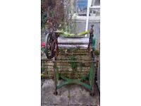 Vintage/antique mangle used for garden ornamentation