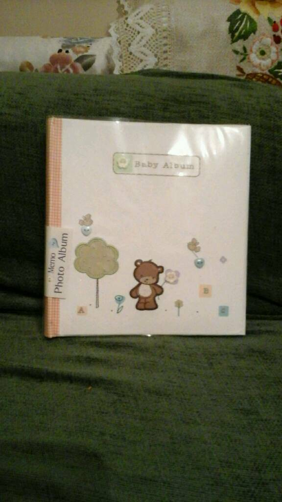 Baby photo album for 144 photos, never been used