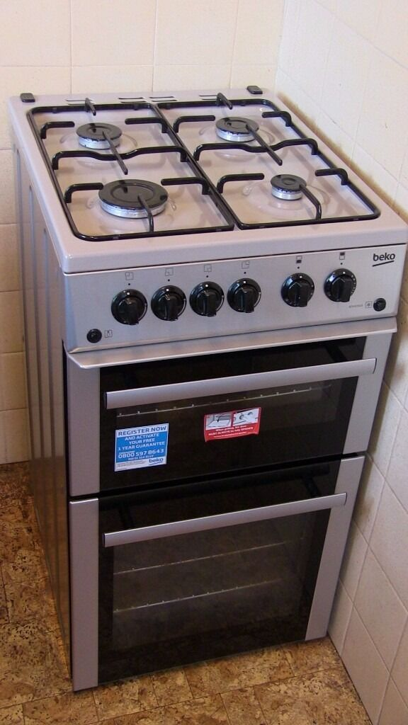 Freestanding silver Beko gas cooker - about 1 year old