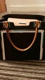 Black and tan handbag
