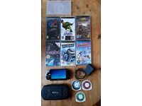 PSP 1003 + approx 60 PSP games + accessories + 8GB memory card + classic emulators & games