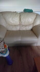 2 seater and 3 seater cream leather sofa's