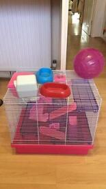 Hamster cage with pink running ball