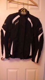 Ladies RST motorcycle jacket Size 10 mainly black, white logo unused but without tags