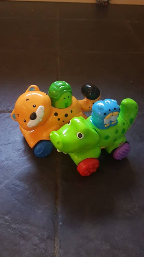 Crocodile and tiger Fisher price amazing animals push