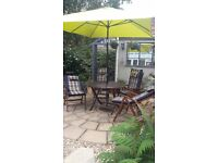 LUXURY HARDWOOD TABLE SET 4 reclinable chairs with reversable cushions as new huge parasol and base.