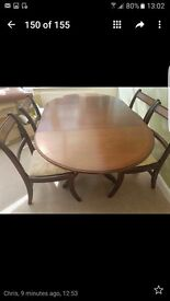 Dark wood adjustable dining table and 4 chairs .....claw feet ..good condition ..buyer to collect