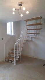 retro white metal spiral staircase