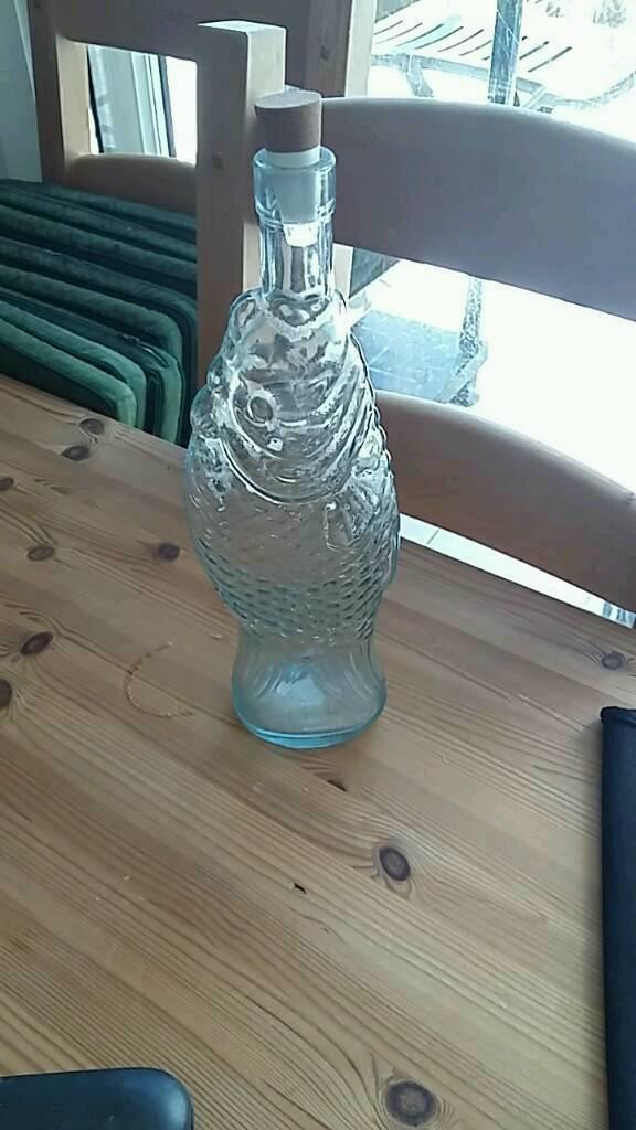 Retro 80's fish shaped wine bottle.