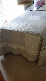 Patchwork throw bedspread for single bed.