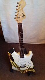 Electric guitar, squier fender stratocaster, cream.