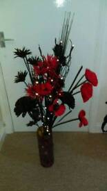 Black , red flowers with lights display