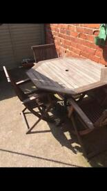 Wooden table and chairs with umbrella
