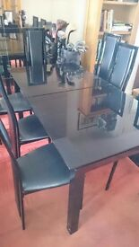 Harveys dining table and 8 chairs