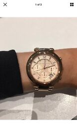 Michael Kors rose gold watch in very good condition with spare links and box.