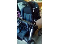 I'coo pram. Almost good as new. Pram top and chair. Navy blue. Rain cover incuded.