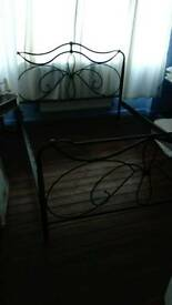 Black metal king size bed frame