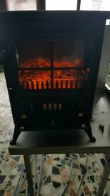 Immitation log burner fan heater