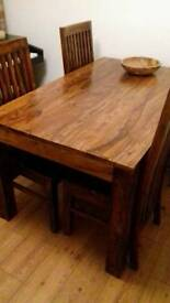 4 or 6 seater hardwood dining table with 4 chairs. Over £1000 new!
