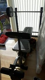 Weight bench with barbell and dumbells