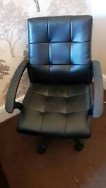 Glass desk and office swivel chair
