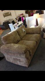 Perfect condition light brown jumbo chord sofa.