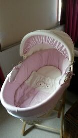 Pink and cream moses basket with stand.