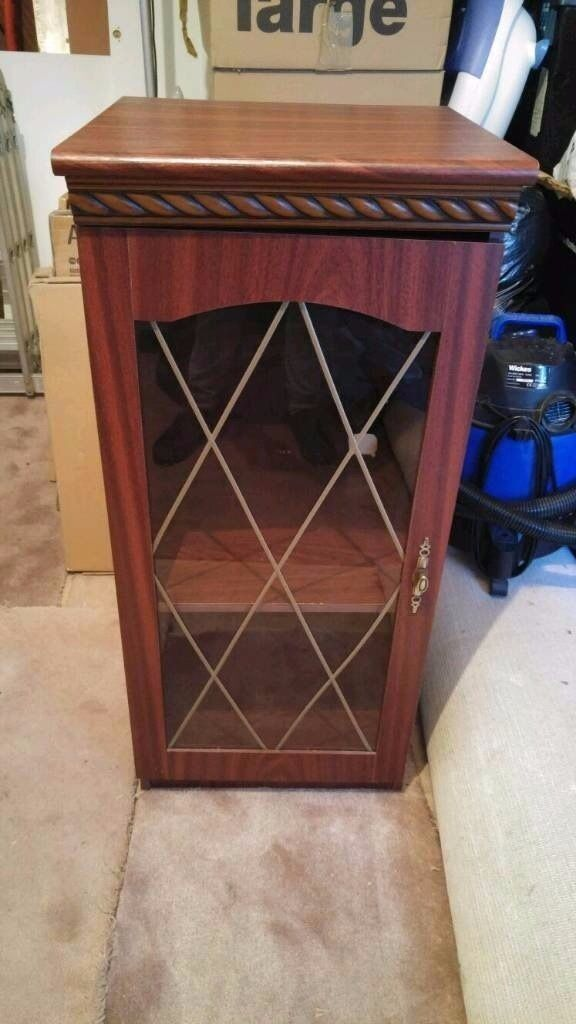 Wooden Cabinet with leaded glass doorin Stanningley, West YorkshireGumtree - For sale is a wooden cabinet with glass door. Was used for a Hi Fi system has a hole cut out at the back for cables. Overall kept in good condition