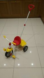 Fisher Price tricycle with detachable handle for adult supervision, good condition