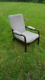 Vintage easy chair with padded arms high backed lounger parker knoll Cintique