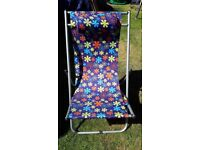 Retro garden chair. Has head cushion incorporated in the chair whi h folds flat for easy storage