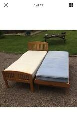 Single hardwood pullout bed with mattresses