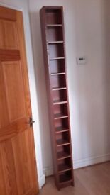 CD cabinet, dark wood effect. H 203cms x W 20cms x D 17cms. Excellent condition.
