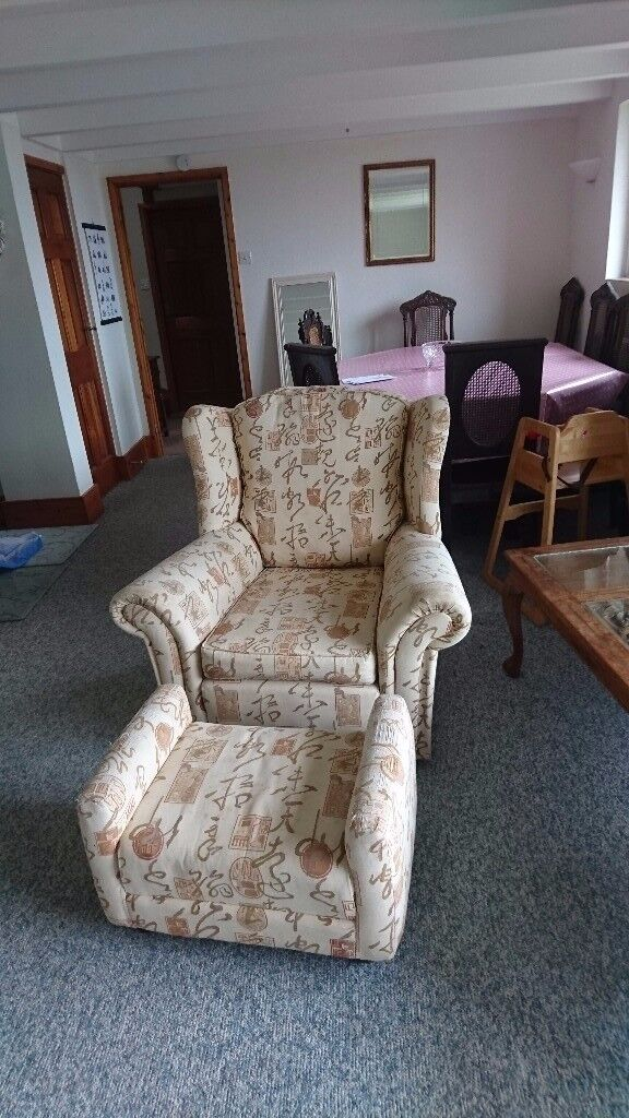 Three piece suute, three seater sofa and two armchairs with footrest