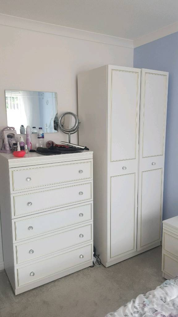 Bedroom furniture setin Neath, Neath Port TalbotGumtree - Great condition white bedroom furniture with crystal style handles. Relocation leads to sale. Been used in a spare room so very well presented.2 x bedside tables1 x double wardrobe with internal shelf1 x chest of drawers (no bowing in any drawer)