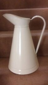 Large cream coloured metal jug, excellent condition, 15 ins. high.