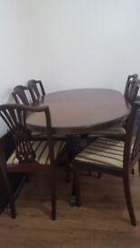 Extendable dinning table and 8 chairs used. In good condition collecttion only.