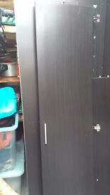 3 door wardrobe in dark wood effect. Fully dismantled for easy collection. Used but good condition.