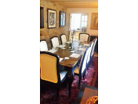 Fabulous large Dining Room table, 10 chairs, Large Cupboard and 2 side cupboards