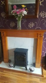 solid oak fire surround with fire