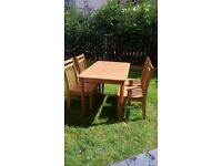 Lovely ceramic tile top table and 4 chairs