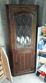 Ornate dark solid wood corner unit