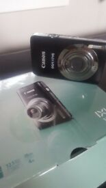 Canon digital camera black IXUS 117 HS, 12.1 mega pixel, comes with box and wires