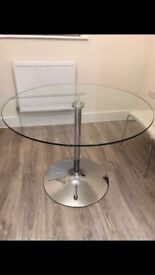 Lovely round glass dinning table with chrome base
