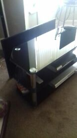 Smoked glass/chrome 3 tier TV Stand. AS NEW..x