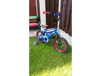 """Boys 14 """" starship bike with stabilizers can deliver for a small charge"""