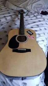 Left handed acoustic Guitar with gig bag