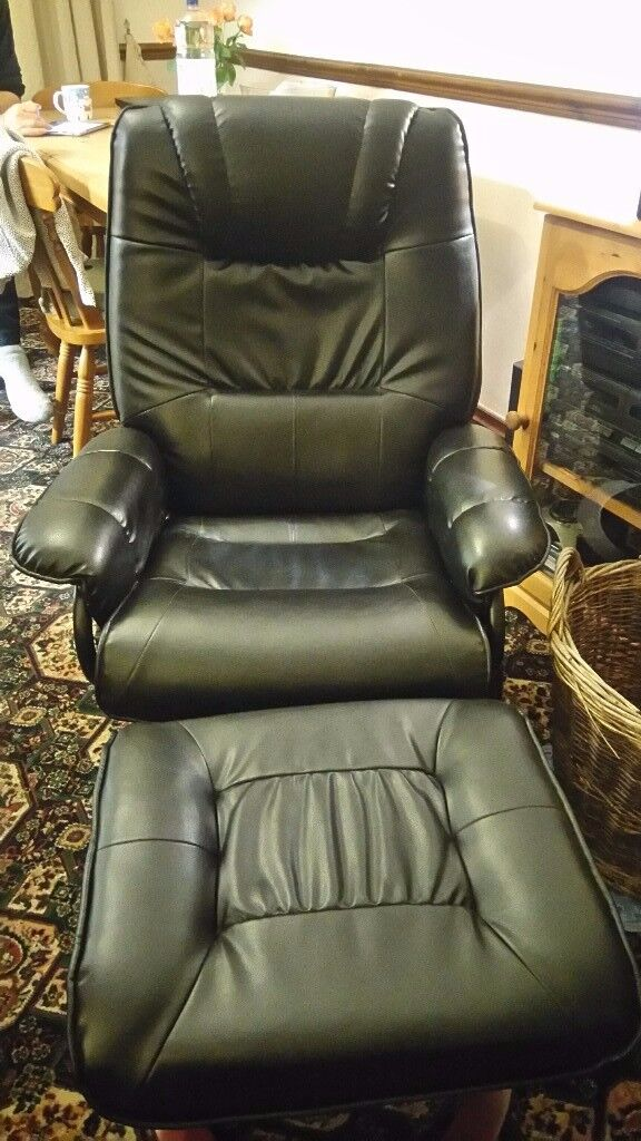 Reclining, heated, vibrating chair with footstool