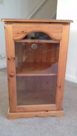 Pine glass fronted cabinet